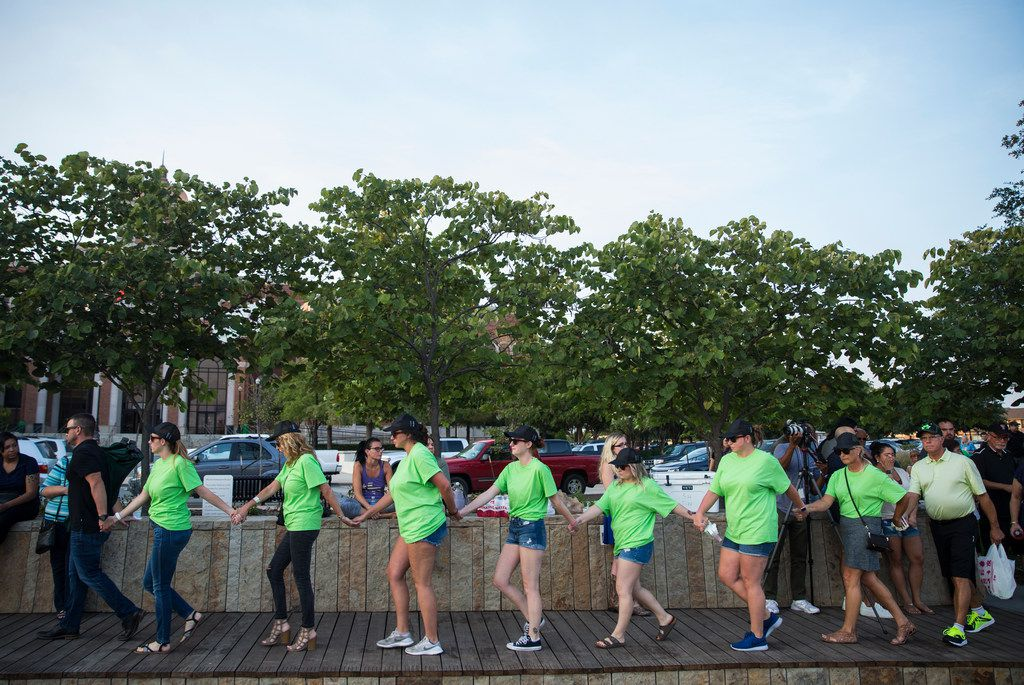 Family members arrived at the vigil Thursday wearing green T-shirts. Green was Ashton's favorite color.