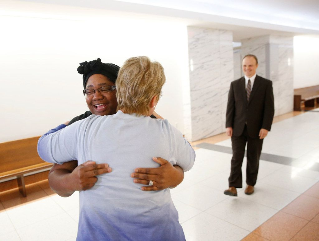 Stacey Jackson hugs Ellen Lessem, paralegal, as her lawyer, Joshua J. Bennett walks up after a jury found Beamers bar partially liable for the death of Jerry Brown after being killed by Dallas Cowboys player Josh Brent while driving intoxicated, at George L. Allen, Sr. Courts Building in Dallas on Dec 13, 2018.