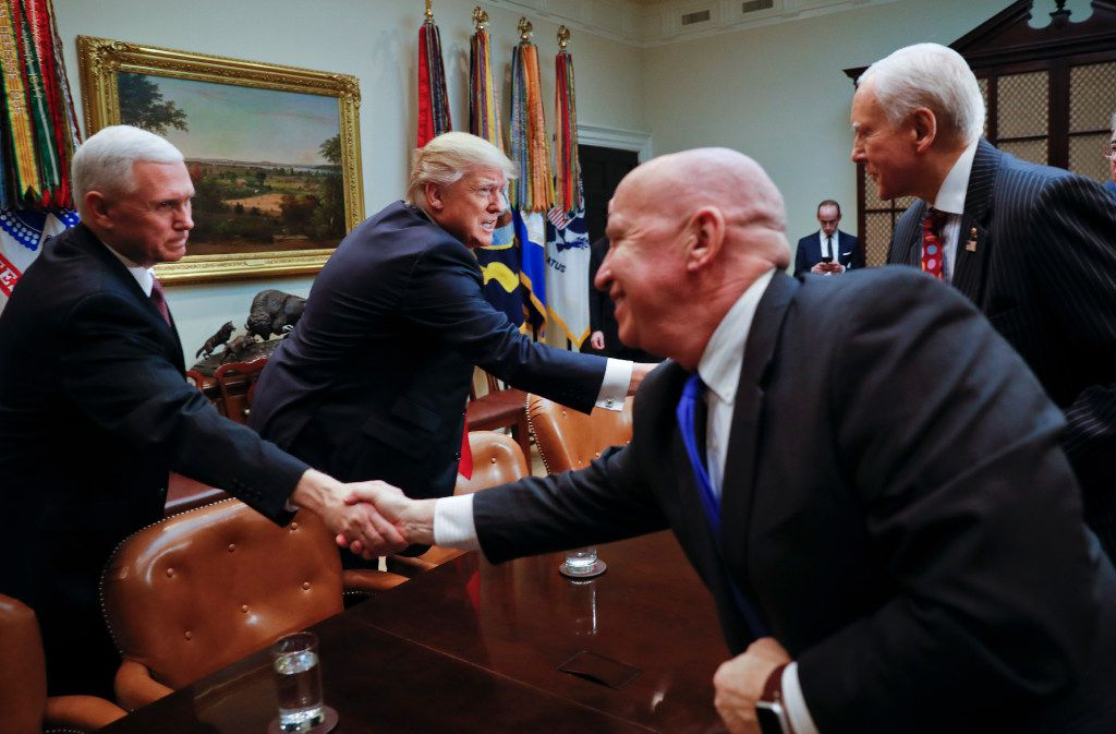 President Donald Trump and Vice President Mike Pence greet Rep. Kevin Brady, R-Texas, center, and Sen. Orrin Hatch, R-Utah during a meeting in the Roosevelt Room of the White House on Thursday. (AP/Pablo Martinez Monsivais)
