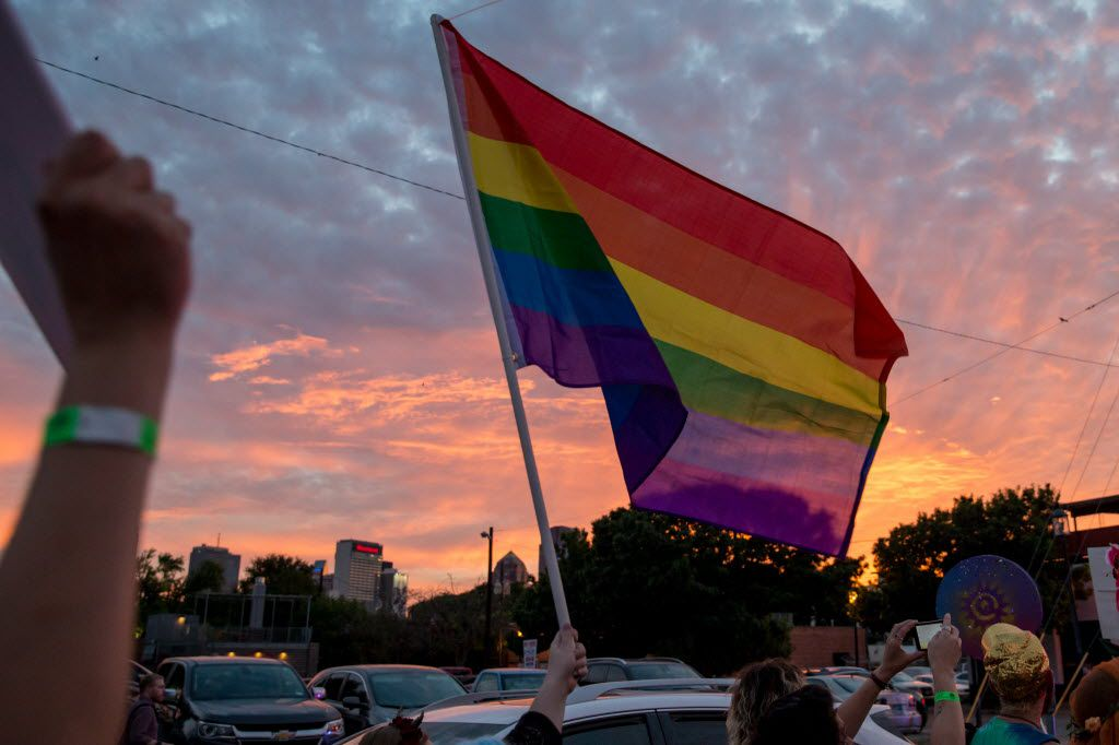 Attendees of the Queer Bomb Dallas march though Deep Ellum streets with the Rainbow Flags on June 25, 2016 in Dallas. (Ting Shen/The Dallas Morning News)