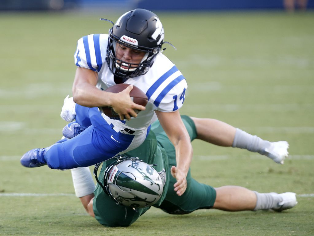 Plano West quarterback Andrew Picco (14) is taken down by Reedy linebacker Michael Swope (8) during the first half as Reedy High School hosted Plano West High School in a non-district football game at Toyota Stadium in Frisco on Thursday, August 28, 2019. (Stewart F. House/Special Contributor)