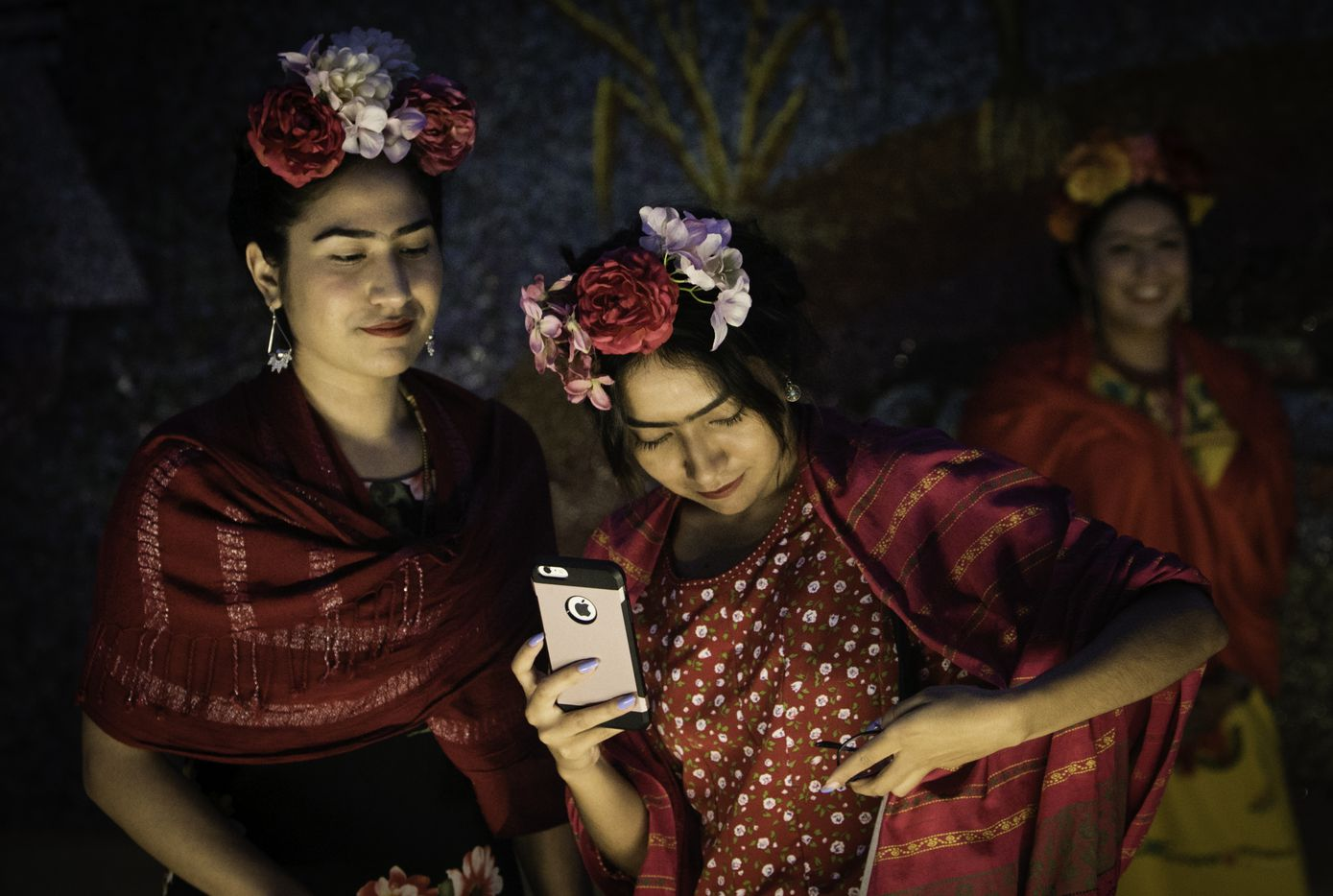 Sisters Grecia and Ilse Rangel take photographs after the attempt to break the Guinness World Record for the largest gathering of people dressed as Frida Kahlo in one location at the Dallas Museum of the Art in Dallas on July 6, 2017.