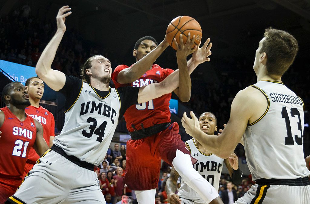 SMU guard Jimmy Whitt (31) is fouled by UMBC forward Max Portmann (34) during the second half of an NCAA men's basketball game at Moody Coliseum on Friday, Nov. 10, 2017, in Dallas. SMU won the game 78-67. (Smiley N. Pool/The Dallas Morning News)