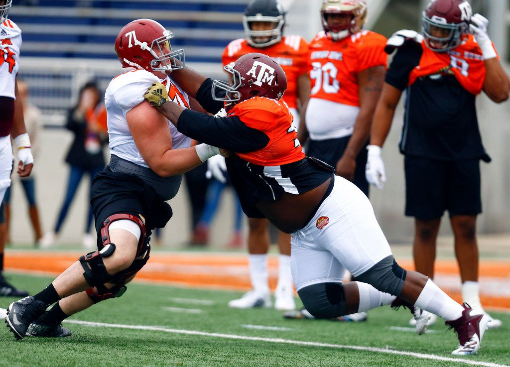 South center Ross Pierschbacher of Alabama (71) runs drills with South defensive tackle Daylon Mack of Texas A&M (34) during practice for Saturday's Senior Bowl college football game, Tuesday, Jan. 22, 2019, in Mobile, Ala. (AP Photo/Butch Dill)