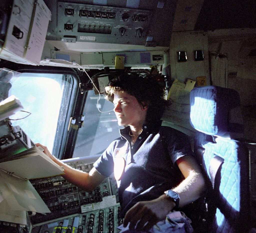 In this June 1983 photo released by NASA, astronaut Sally Ride, a specialist on shuttle mission STS-7, monitors control panels from the pilot's chair on the space shuttle Challenger.