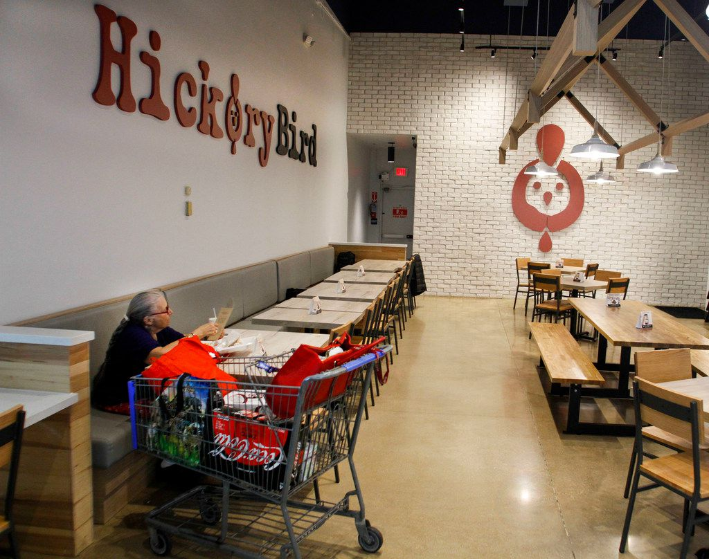 Karen Campbell sits looking over the menu after eating lunch with her basket of groceries at the first Hickory Bird.