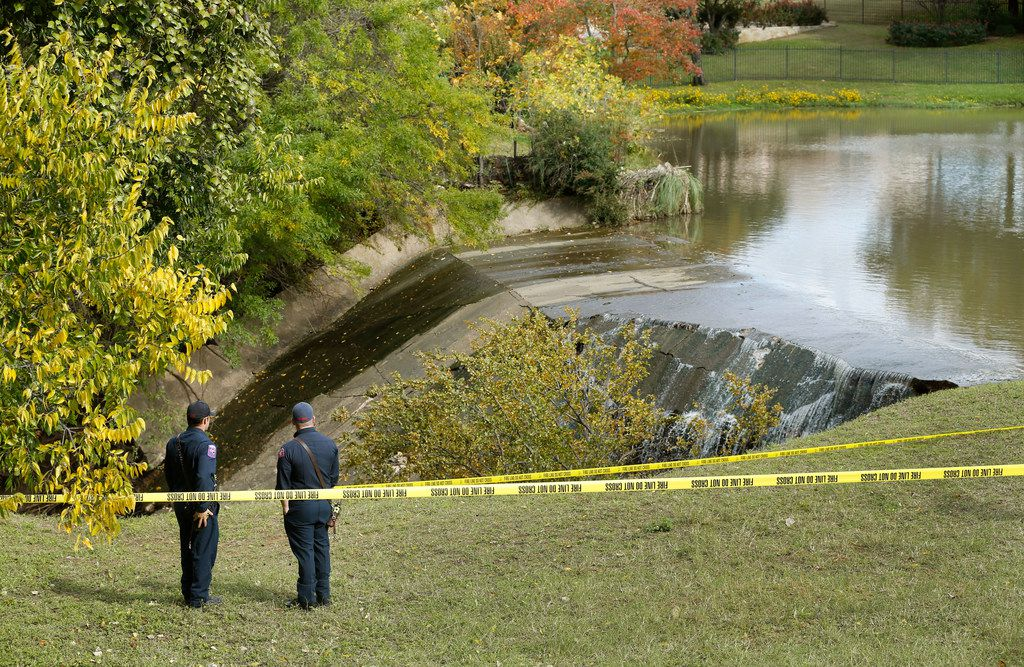 "A pair of Arlington firefighters monitor Prestonwood Lake dam in northwest Arlington which was compromised by recent rains, Thursday, November 1, 2018. The City of Arlington has declared an emergency in anticipation of possible flooding downstream from the dam. The City has said,  ""It appears failure of the spillway may be imminent."" Green Oaks Blvd, a six-lane divided street, and the Village Creek Waste Water Treatment Plant are in the drainage path less than a half-mile from the dam. (Tom Fox/The Dallas Morning News)"
