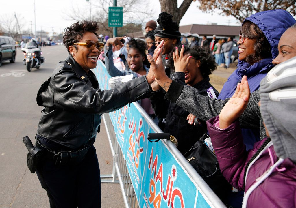 Dallas Police Chief U. Renee Hall greets people as she walks down Martin Luther King Jr. Blvd. during the 37th Annual MLK Parade in Dallas on Saturday, January 21, 2019. (Vernon Bryant/The Dallas Morning News)