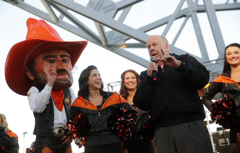 Oklahoma State alum T. Boone Pickens, Jr. fires up the Cowboy fan base during a tailgate party on the East Plaza of AT&T Stadium before the Cotton Bowl game against Missouri, Friday, January 3, 2014 in Arlington, Texas.