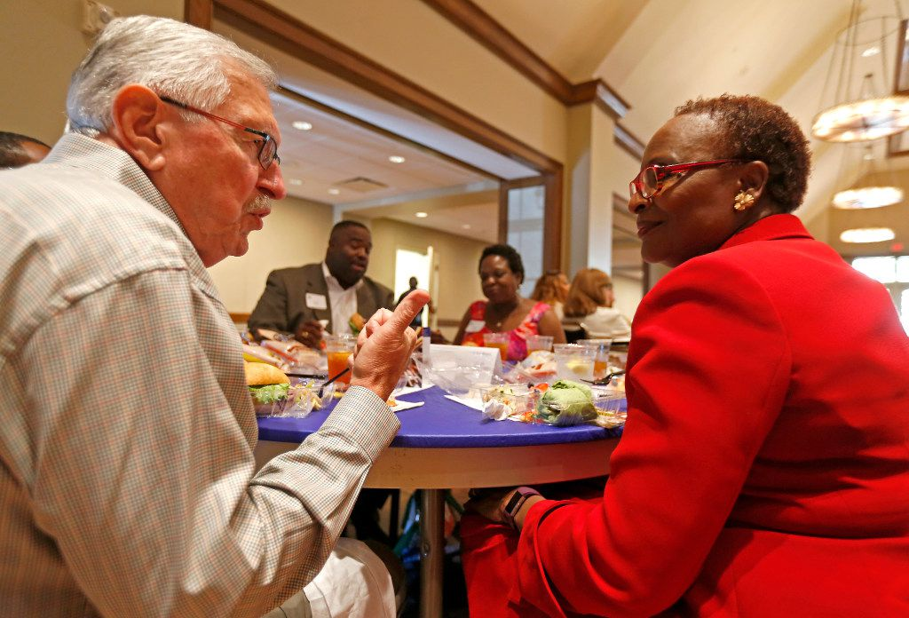 Roy Vandiver visits with Juanita Pounds at the dining table during the Together We Dine event at Highland Park United Methodist Church in Dallas on Tuesday, June 20, 2017.