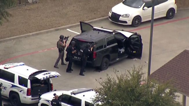 Footage from a news helicopter showed authorities taking positions behind a Texas DPS SUV.