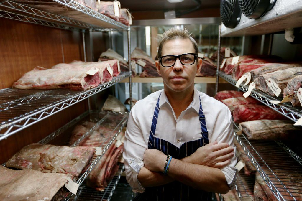 Chef John Tesar stands near dry-aged prime cuts in the meat locker at the Knife restaurant in Dallas Wednesday July 9, 2014.