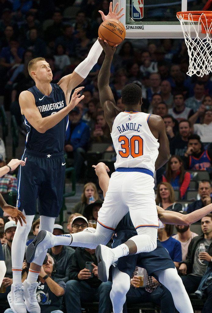 Dallas Mavericks forward Kristaps Porzingis (6) blocks a shot by New York Knicks forward Julius Randle (30) during the first half of an NBA basketball game at American Airlines Center on Friday, Nov. 8, 2019, in Dallas. (Smiley N. Pool/The Dallas Morning News)