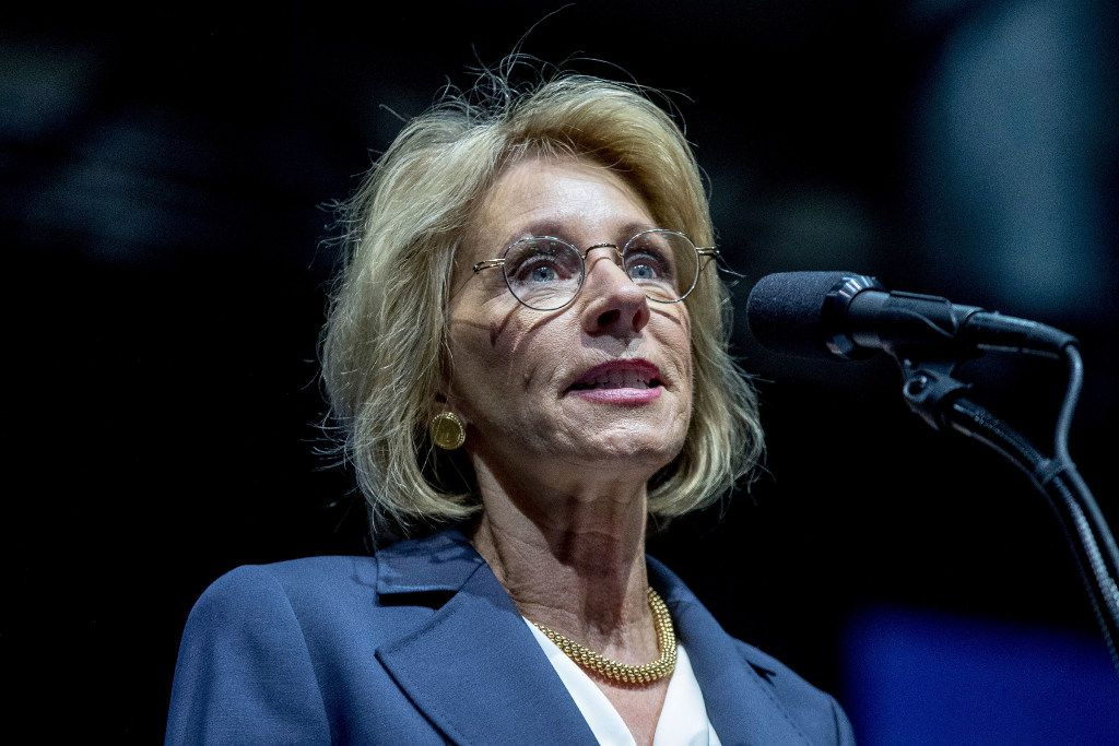 President-elect Donald Trump's pick for education secretary, Betsy DeVos, speaks during a rally at DeltaPlex Arena, Friday, Dec. 9, 2016, in Grand Rapids, Mich. (AP Photo)