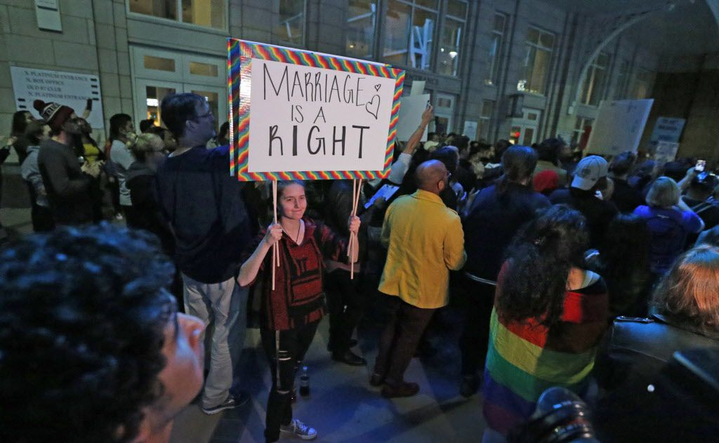 Protesters rally on Victory  Plaza during the Next Generation Action Network's protest against a Trump presidency held outside the American Airlines Center in Dallas on Wednesday, November 9, 2016.