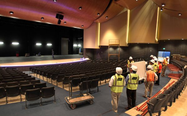 """The state-of-the-art auditorium at the new Adamson High School in north Oak Cliff seats 580 and features impressive woodwork and a spacious stage. """"This is gorgeous,"""" one council member said on a tour last week."""