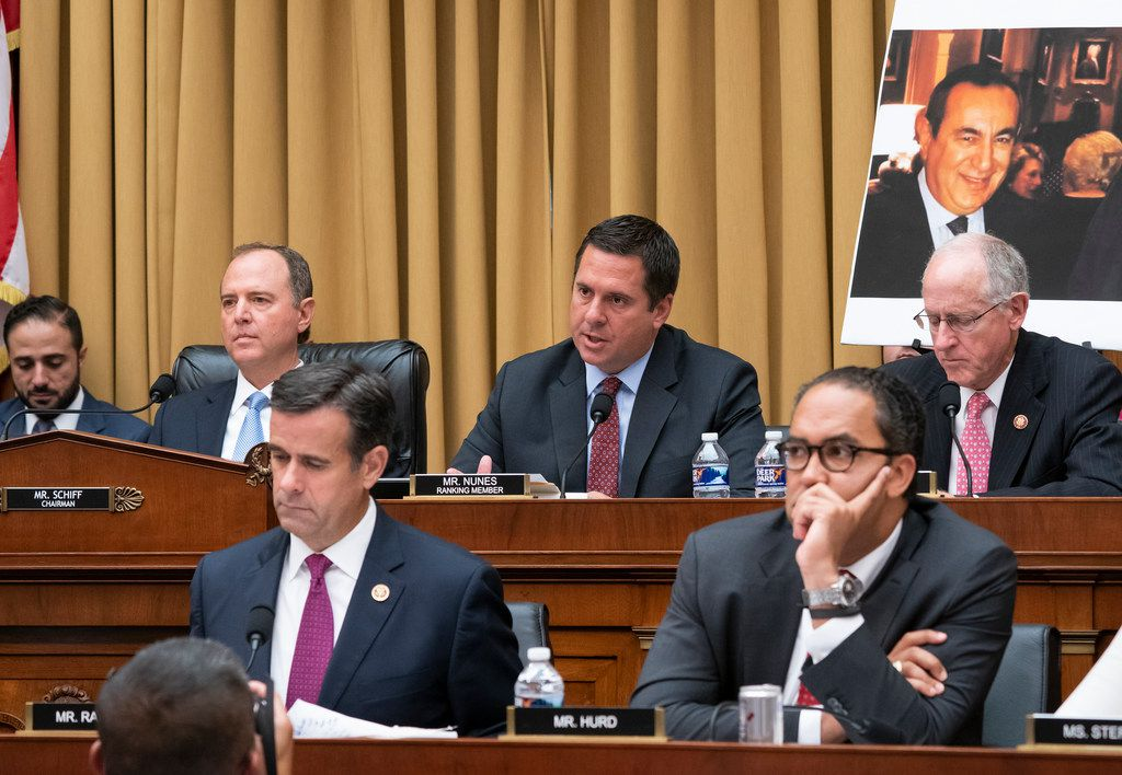 On top row, from left, House Intelligence Committee Chairman Adam Schiff, D-Calif., Rep. Devin Nunes, R-Calif., the ranking member, and Rep. Mike Conaway, R-Texas, join on bottom row, from left, Rep. John Ratcliffe, R-Texas, and Rep. Will Hurd, R-Texas, listen as former special counsel Robert Mueller testifies to the House Intelligence Committee about his investigation into Russian interference in the 2016 election, on July 24, 2019. (AP Photo/J. Scott Applewhite)