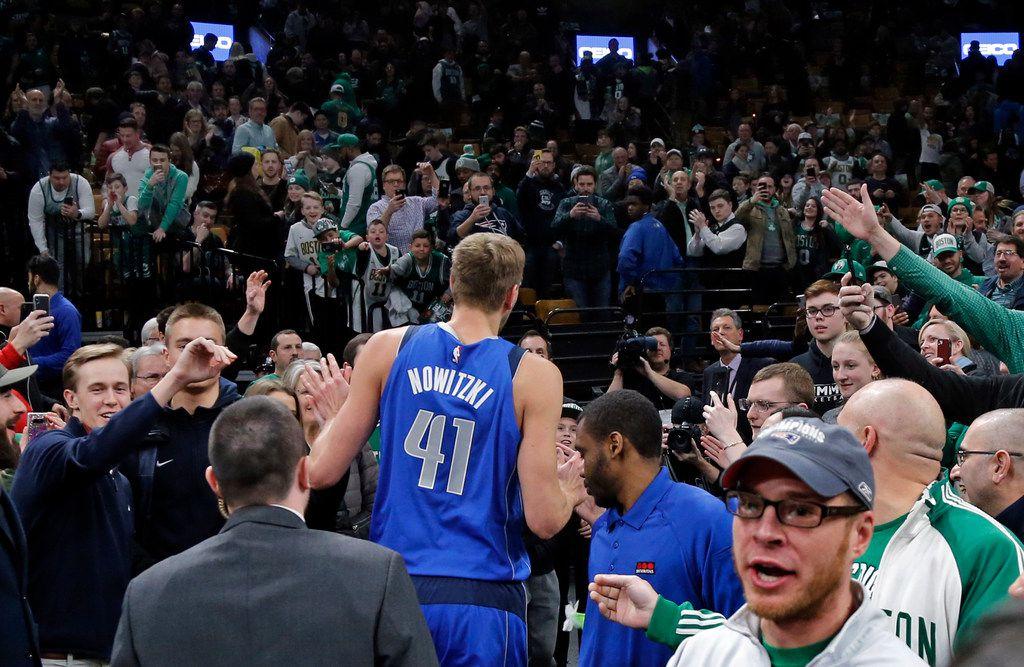 Fans applaud Dallas Mavericks forward Dirk Nowitzki as he leaves the TD Garden floor after an NBA basketball game against the Boston Celtics, Friday, Jan. 4, 2019, in Boston. The Celtics won 114-93. (AP Photo/Elise Amendola)