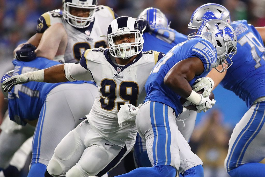 DETROIT, MI - DECEMBER 02: Aaron Donald #99 of the Los Angeles Rams tackles running back Theo Riddick #25 of the Detroit Lions during the first half at Ford Field on December 2, 2018 in Detroit, Michigan. (Photo by Gregory Shamus/Getty Images)