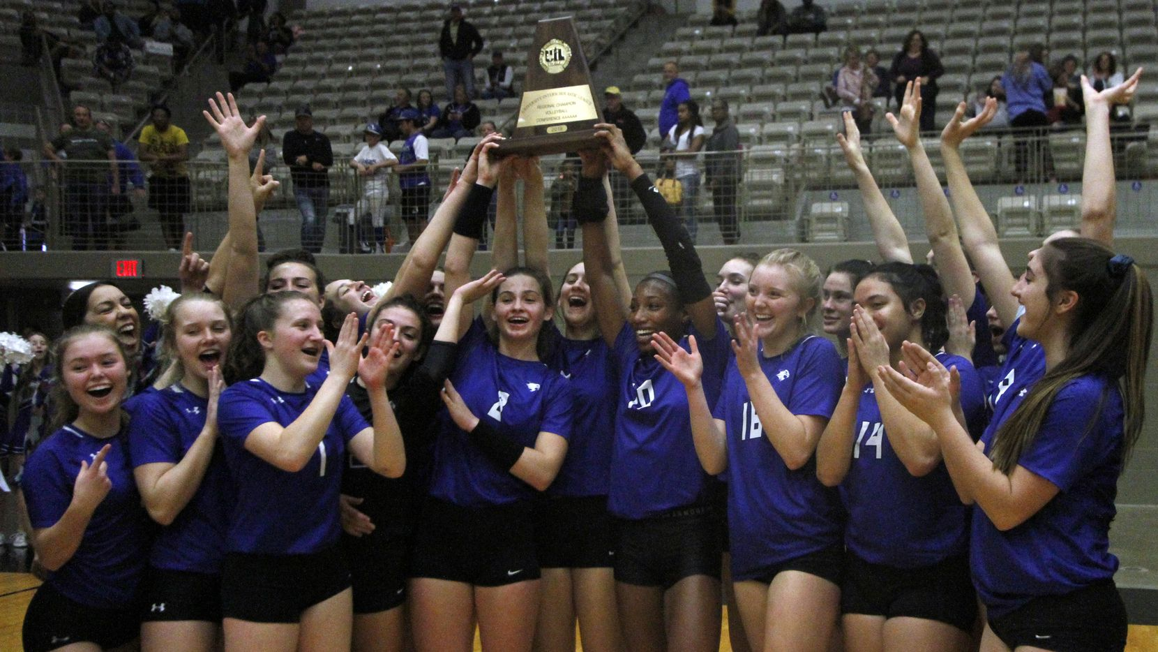 Trophy Club Byron Nelson celebrates a 25-17, 25-17, 25-16 victory over Denton Guyer in Saturday's Class 6A Region l championship match at W.G. Thomas Coliseum in Haltom City. (Steve Hamm/ Special Contributor)