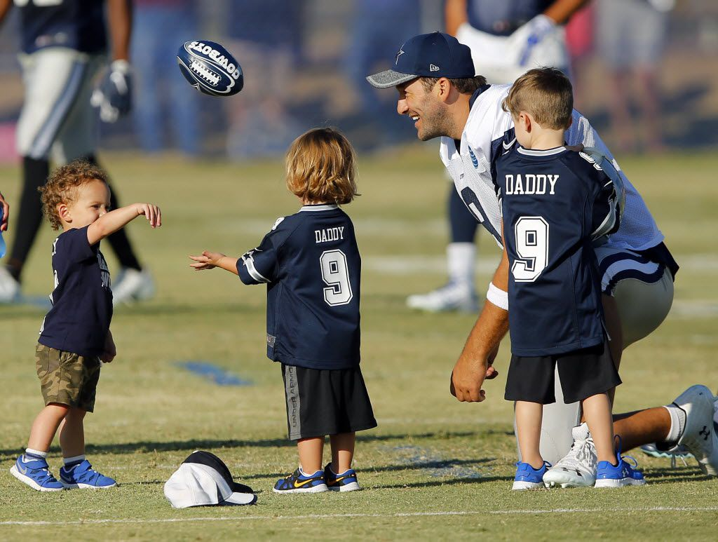 Dallas Cowboys quarterback Tony Romo (9) plays catch with his kids Hawkins Romo (right) and Rivers Romo (middle) and wide receiver Cole Beasley's son Ace Beasley following afternoon practice at training camp in Oxnard, California, Friday, August 5, 2016. (Tom Fox/The Dallas Morning News)