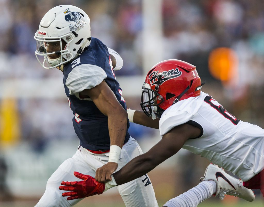 Allen quarterback Raylen Sharpe (3) runs the ball to the end zone for a touchdown ahead of Cedar Hill defensive back Brett Lynch (6) during the first quarter of a high school football game between Allen and Cedar Hill on Friday, August 30, 2019 at Eagle Stadium in Allen. (Ashley Landis/The Dallas Morning News)