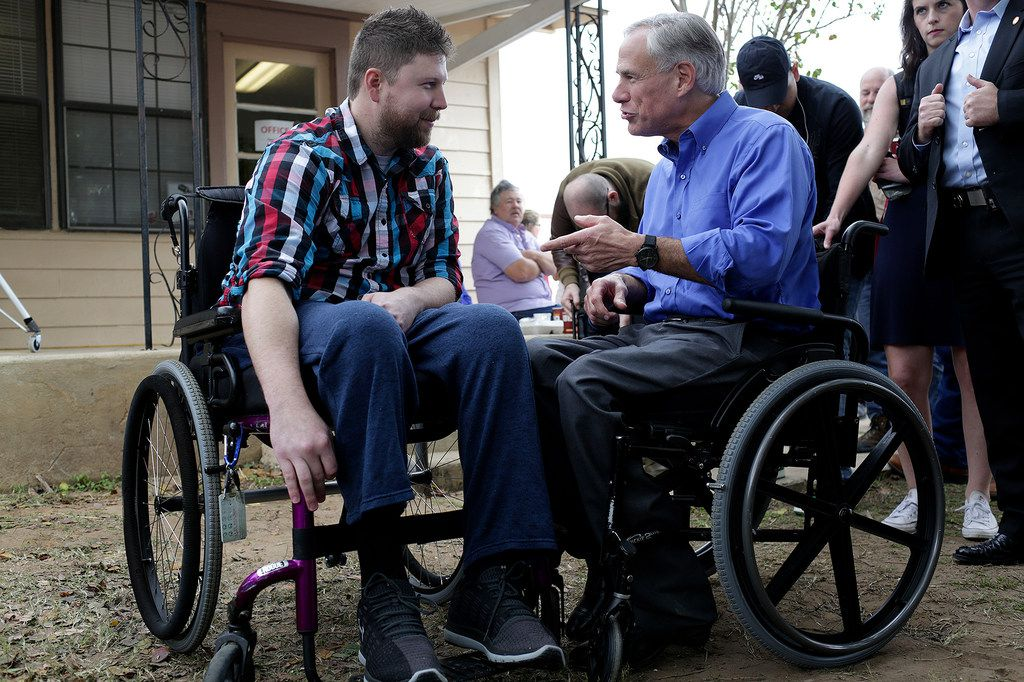 Kris Workman (left), paralyzed in the shooting, talked with Gov. Greg Abbott during Remembering Sutherland Springs: One Year Later at First Baptist Church of Sutherland Springs on Sunday.