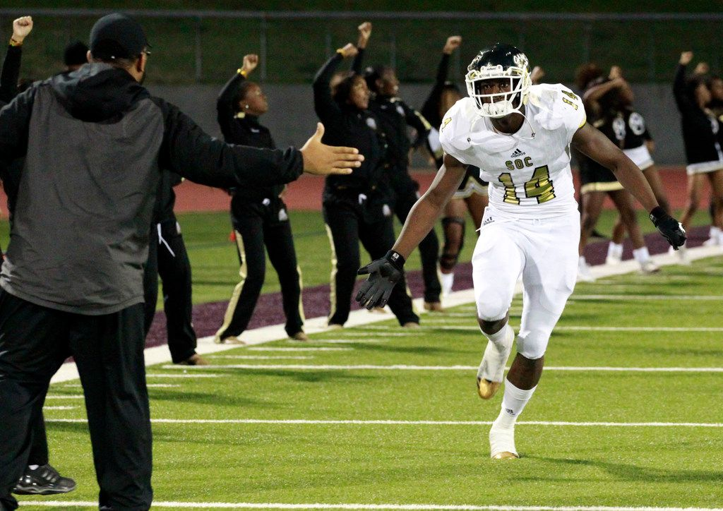 South Oak Cliff star defensive lineman Steven Parker (14) takes the field before the start of a high school football game against Kimball at Kincaide Stadium in Dallas on Saturday, November 2, 2018.  South Oak Cliff won the game 56-7. (John F. Rhodes / Special Contributor)