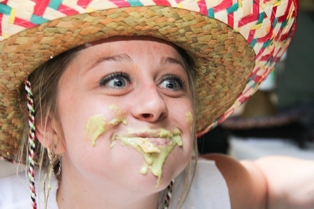 Shana Hagemeyer participated in the Bob Armstrong dip eating contest at the Cinco De Mayo celebration at Mattitos in Uptown on May 5, 2015