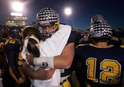 Highland Park QB Matthew Stafford (7) hugs a cheerleader after the Scots won the 4A Division I State High School Football Championship game. Highland Park High defeated Marshall High 59 - 0 at the Rose Stadium in Tyler, TX on Saturday, December 10, 2005.