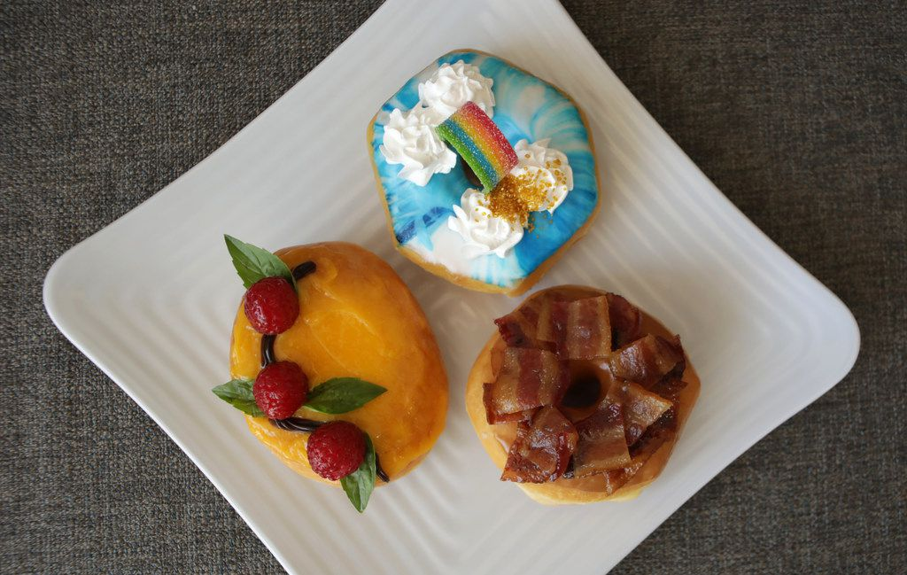 Clockwise from bottom left: Passion fruit with raspberry, Over the Rainbow and Maple Bacon doughnuts.