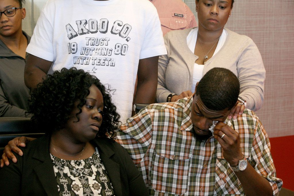 Odell Edwards wipes away tears as he sits with his wife, Charmaine Edwards, listenintg to their attorney Lee Merritt talking about the death of their son, Jordan Edwards, in a police shooting Saturday in Balch Springs, Texas in Merritt's law office in Dallas Monday, May 1, 2017. (Guy Reynolds/The Dallas Morning News)