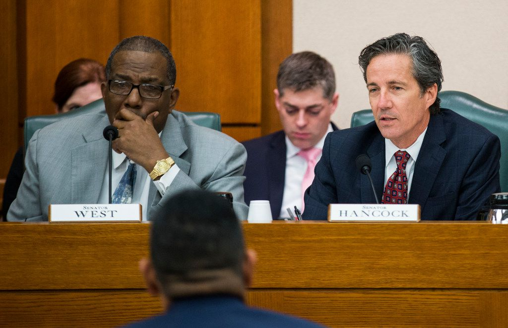 Senator Royce West of Dallas (left) and Senator Kelly Hancock of Flower Mound (right) listen to public testimony at a senate committee hearing on SB3, which would give teachers a $5,000 pay raise next year, on Monday, February 25, 2019 at the Texas state capital extension in Austin. (Ashley Landis/The Dallas Morning News)
