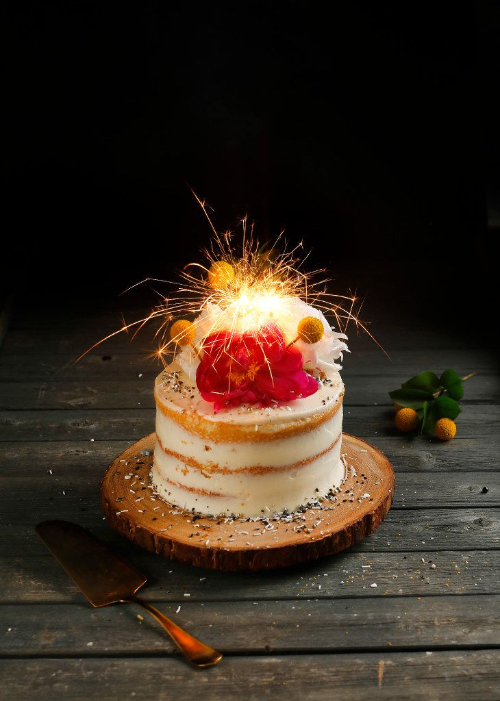 Local baker Kristen Massad's celebration cake, including a star sparkler, is called the Naked Vanilla Layer Cake, with strawberries, lemon curd and buttercream icing.