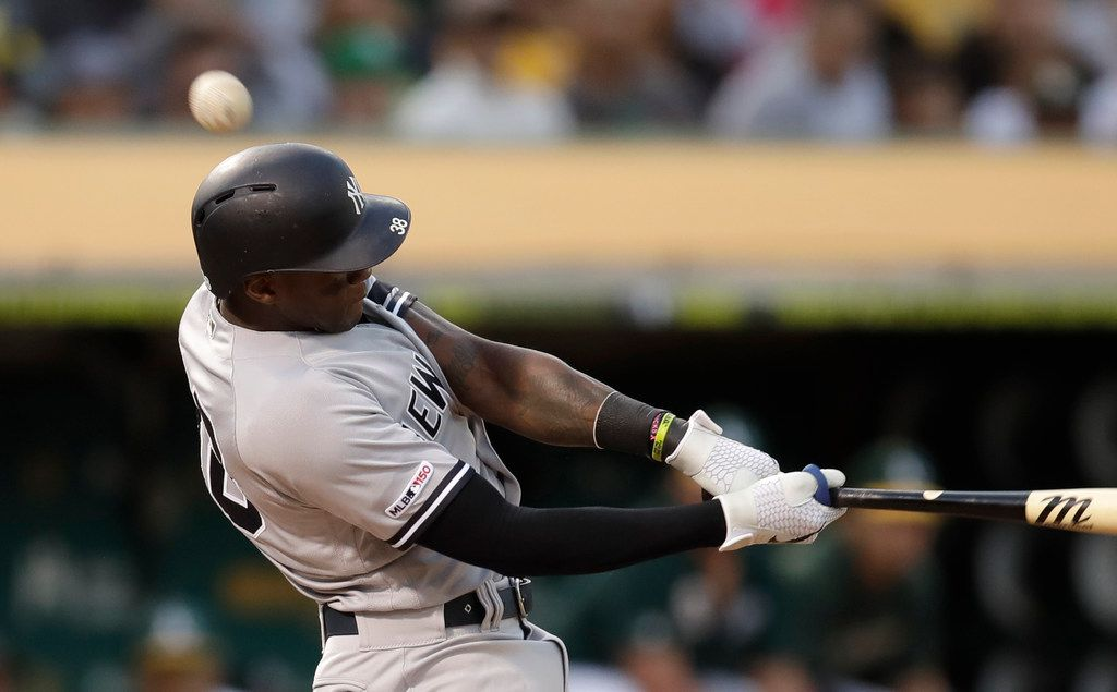 New York Yankees' Cameron Maybin fouls a ball off over his head in the second inning of a baseball game against the Oakland Athletics Wednesday, Aug. 21, 2019, in Oakland, Calif. (AP Photo/Ben Margot)