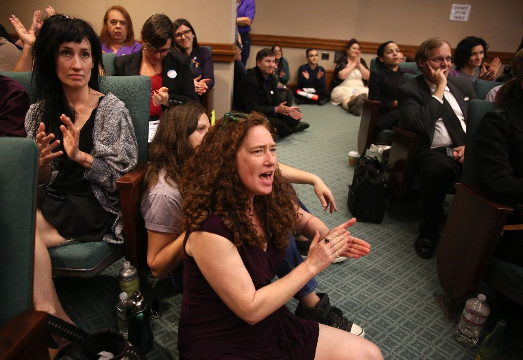 Erica Nix (front) applauds in the overflow room as members of the Senate State Affairs Committee debate and hear public testimony of Senate Bill 6, the transgender bathroom bill, at the Texas State Capitol in Austin on Tuesday, March 7, 2017. The bill would bar transgender people from using the restrooms, locker and changing rooms that correspond to their gender identity in public schools and government buildings. (Rose Baca/The Dallas Morning News)