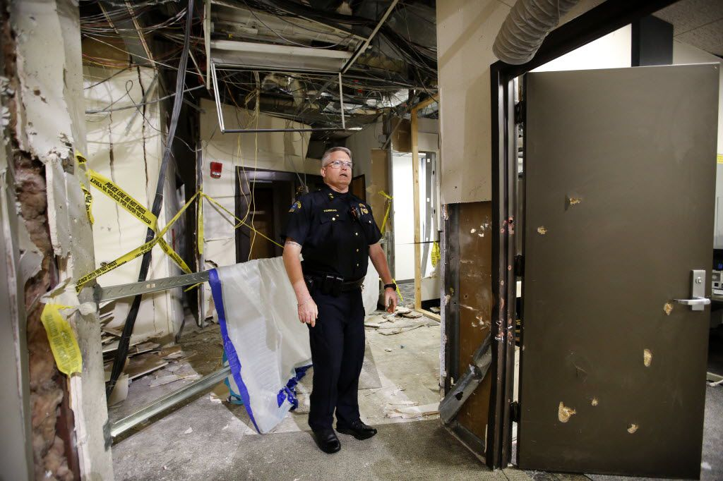 Dallas County College Police Chief Joseph Hannigan on Tuesday showed the spot where the gunman was cornered by police in a second-story hallway at El Centro College in downtown Dallas. Police detonated a bomb, killing the gunman and causing all the structural damage.