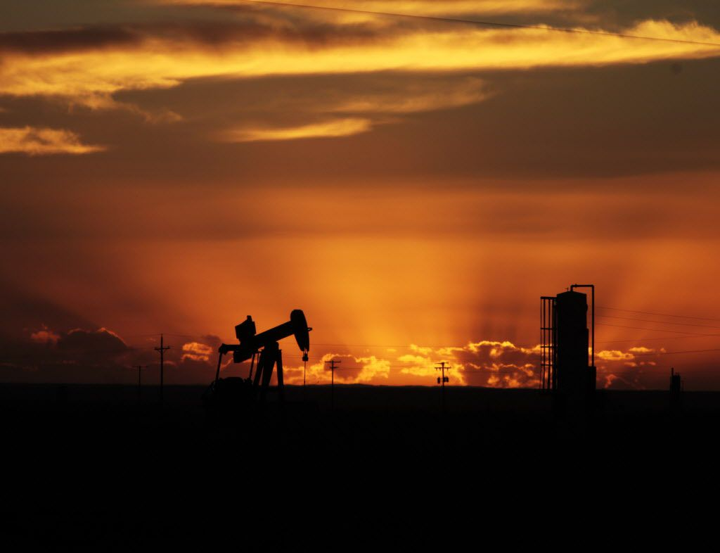 Oil well pumpjacks are scattered about the sparse landscape in Loving County, Texas.  (File Photo/Staff)