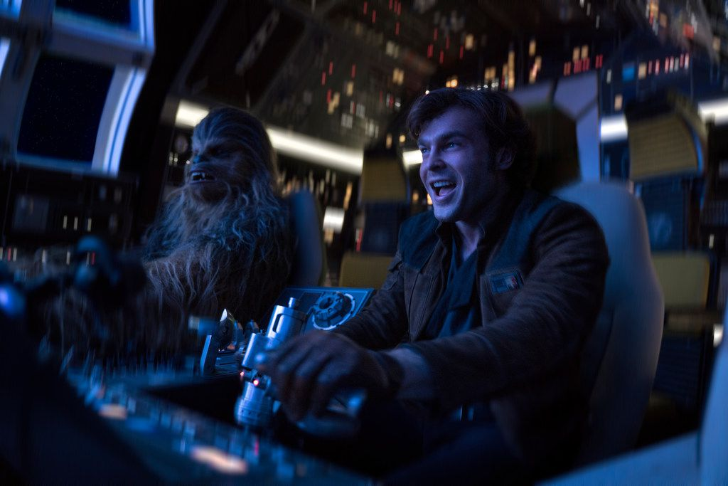 """In this image released by Lucasfilm, Alden Ehrenreich, right, and Joonas Suotamo appear in a scene from """"Solo: A Star Wars Story."""" (Jonathan Olley/Lucasfilm via AP)"""