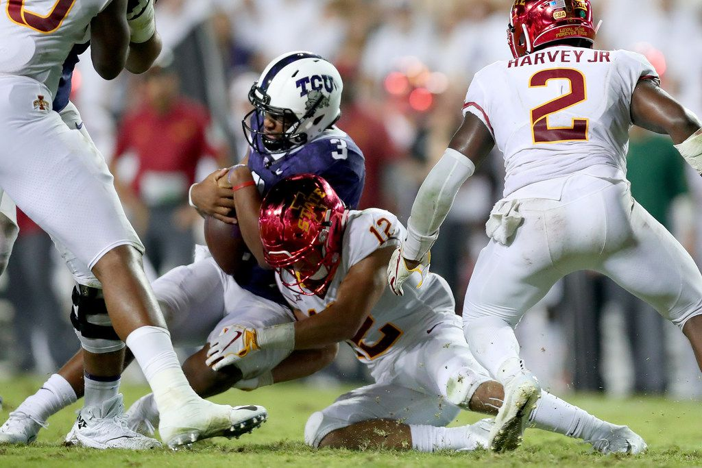 FORT WORTH, TX - SEPTEMBER 29:  Shawn Robinson #3 of the TCU Horned Frogs takes a hit from Greg Eisworth #12 of the Iowa State Cyclones in the fourth quarter at Amon G. Carter Stadium on September 29, 2018 in Fort Worth, Texas.  (Photo by Tom Pennington/Getty Images)