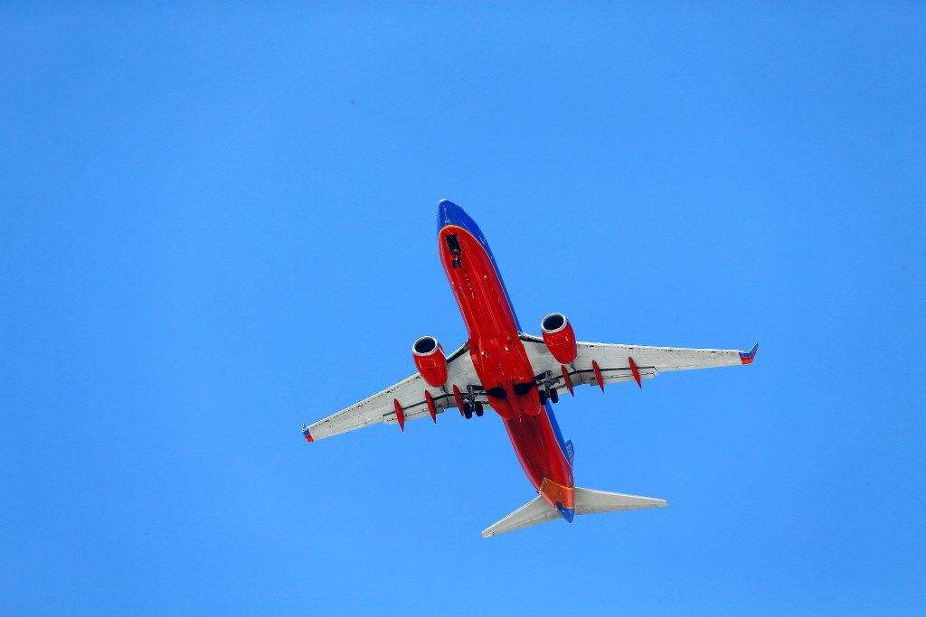 A Southwest Airlines jet makes it's approach to Dallas Love Field as it passes over Standridge Stadium in Carrollton, Texas, Saturday, April 8, 2017. (Tom Fox/The Dallas Morning News)
