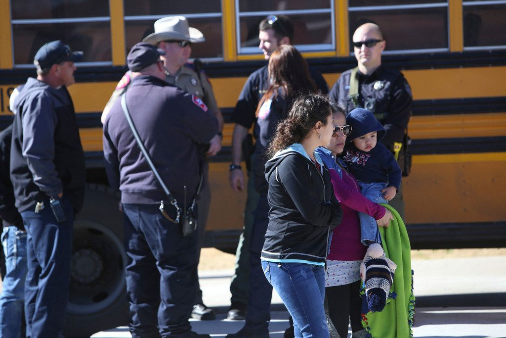 Parents pick up their children at Stafford Elementary school after a shooting at Italy High School on Jan. 22, 2018, in Italy, Texas.