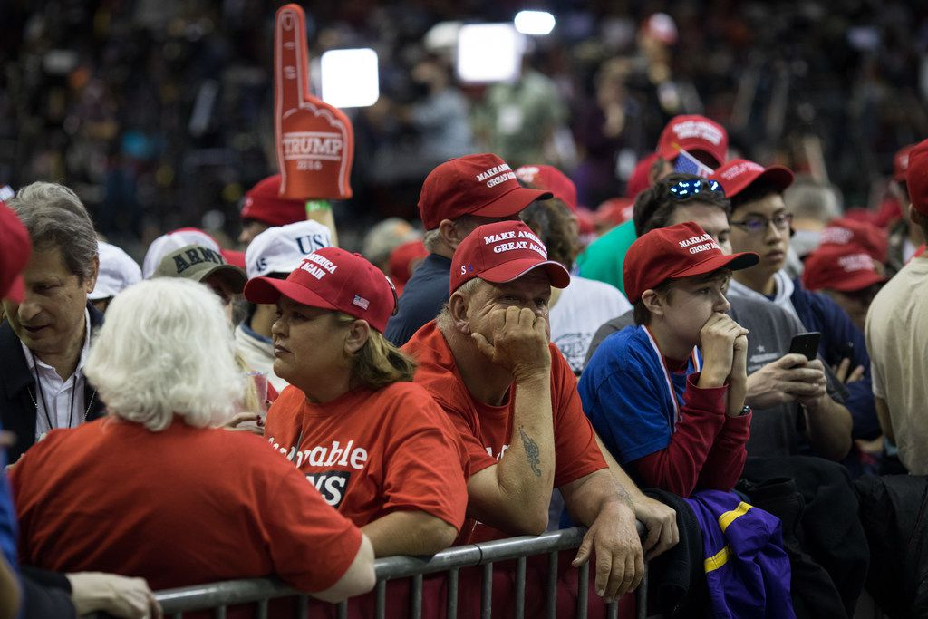 People wait for the start of President Donald Trump's rally in support of Sen. Ted Cruz (R-TX) on October 22, 2018 at the Toyota Center in Houston, Texas. Cruz, the incumbent, is seeking Senate re-election in a high-profile race against Democratic challenger Beto O'Rourke. (Photo by Loren Elliott/Getty Images)