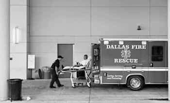 Dallas Fire-Rescue paramedics bring a patient to the ER at Baylor University Medical Center. The city says it's cooperating with authorities over ambulance billing questions.