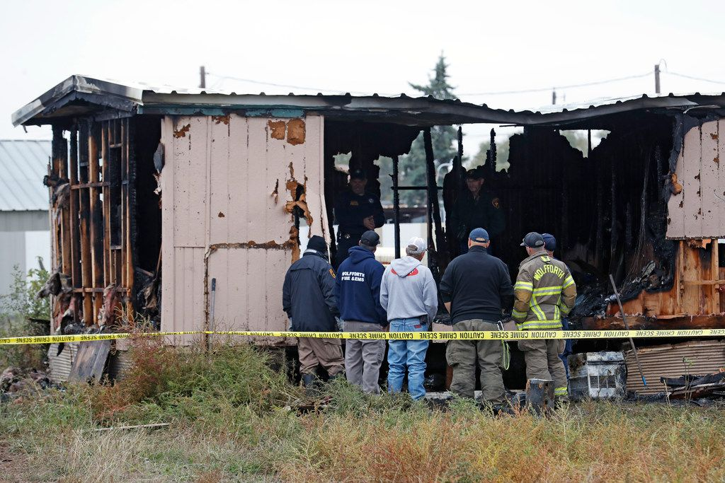 Authorities investigate the cause of a deadly fire Thursday, Nov. 8, 2018, near Wolfforth, Texas. Authorities say several children died in the late-night fire. (Brad Tollefson/Lubbock Avalanche-Journal via AP)