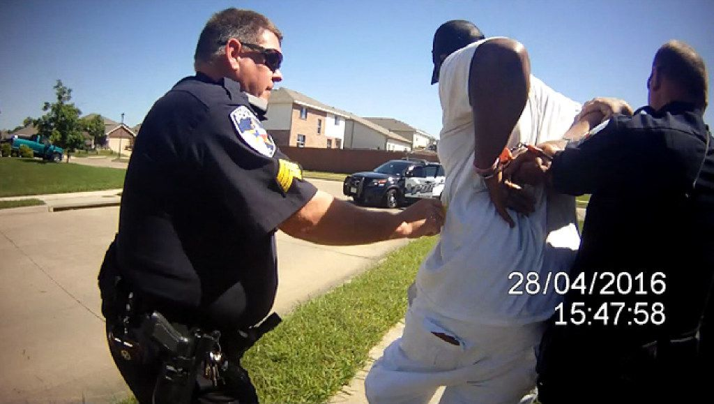 This image from a body camera video of a Balch Springs officer shows Sgt. James Young using a Taser on Marco Stephenson in 2016. Young started tasing Stephenson as Stephenson knelt on the ground with his hands on his head. Young, was investigated by the Texas Rangers but no charges were filed. Another officer who witnessed the incident asked supervisors to review the footage.