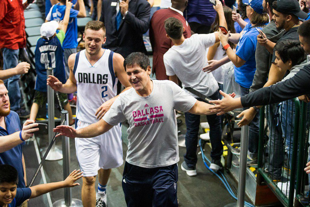 Dallas Mavericks owner Mark Cuban celebrates with fans as he leaves the court with guard Kyle Collinsworth after a win over the Charlotte Hornets in an NBA preseason basketball game at American Airlines Center on Monday, Oct. 3, 2016, in Dallas. (Smiley N. Pool/The Dallas Morning News)