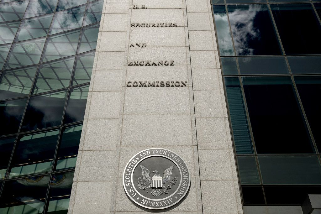 FILE - This Saturday, Aug. 5, 2017, file photo shows the U.S. Securities and Exchange Commission building in Washington. Federal regulators are moving to require that brokers provide their customers with detailed disclosures of their potential conflicts of interest when dispensing advice for retirement planning and other investments. (AP Andrew Harnik, File)