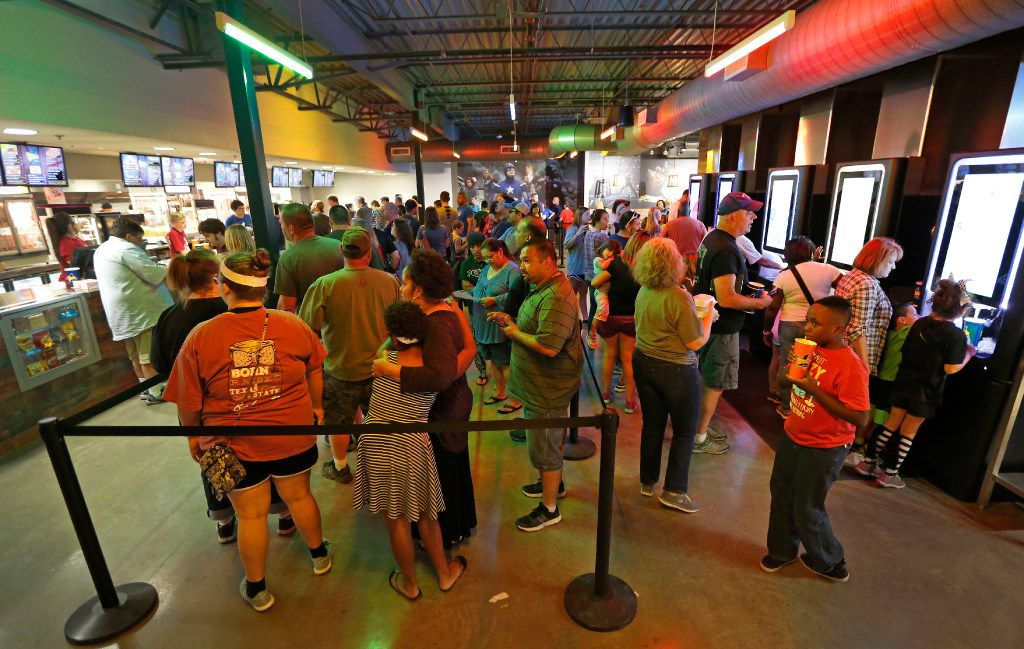 Movie goers line up to buy food and drinks before the movies start at the Coyote Drive-In in Lewisville, Texas, photographed on Saturday, October 29, 2016. (Louis DeLuca/The Dallas Morning News)