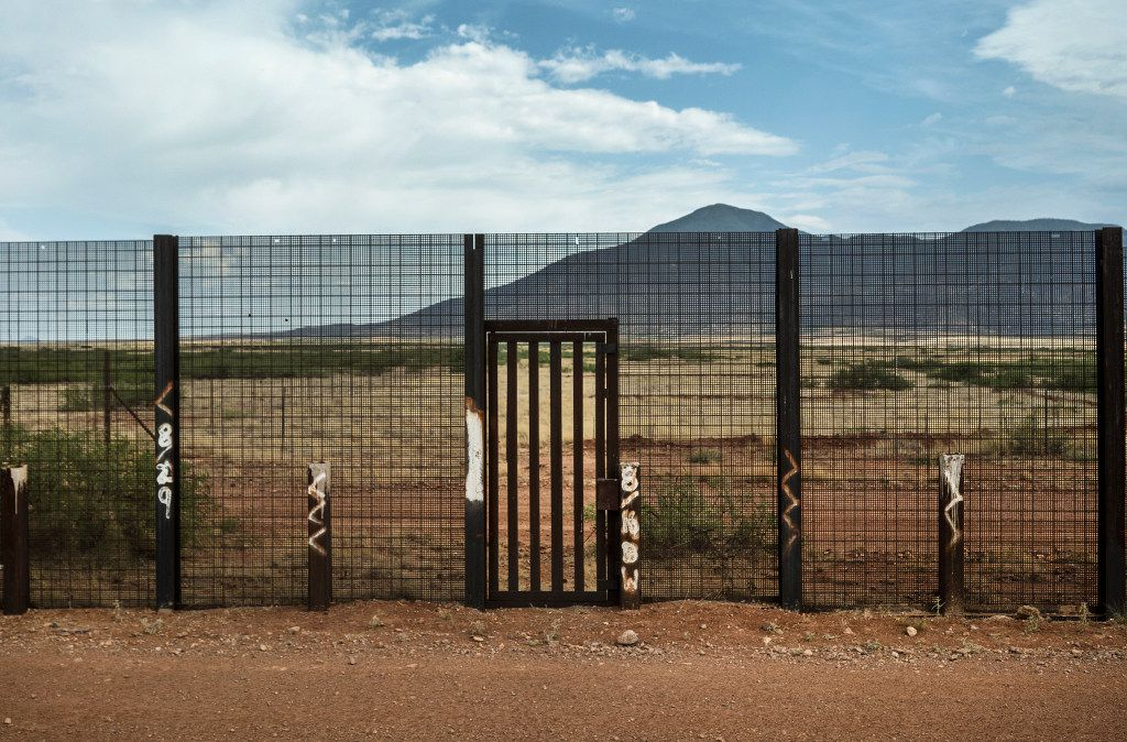 A border fence maintained by the Homeland Security Department sits on private property in Arizona. (Todd Heisler/The New York Times)